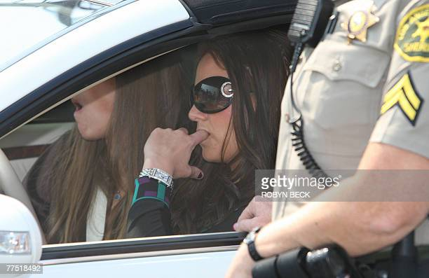 Performer Britney Spears sits at the wheel of her car outside Family Court in Los Angeles, California, 26 October where she was due for a hearing...