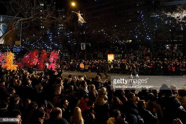A performer dance as she hangs from a balloon during the 'Cabalgata de Reyes' or the Three Kings parade on January 5 2016 in Madrid Spain The...