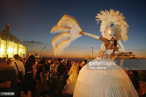 Performer dances at a mass wedding on August 14, 2006 in the old Port of Tel Aviv, Israel. Thirty-two displaced couples from northern Israel were...