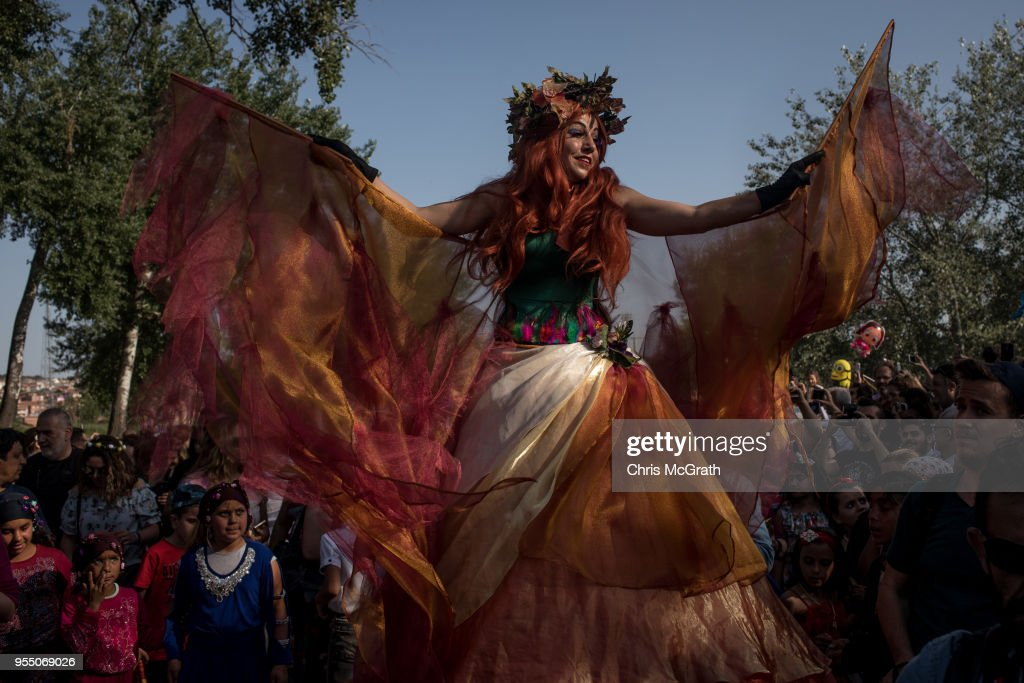 A performer dances for the crowd during the Kakava Festival on May 5, 2018 in Edirne, Turkey. The annual Kakava (Hõdõrellez) spring festival celebrates the coming of spring amongst the Roma community.