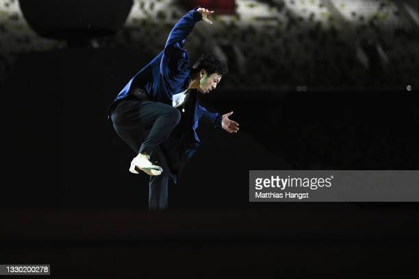 Performer dances on stage during the Opening Ceremony of the Tokyo 2020 Olympic Games at Olympic Stadium on July 23, 2021 in Tokyo, Japan.