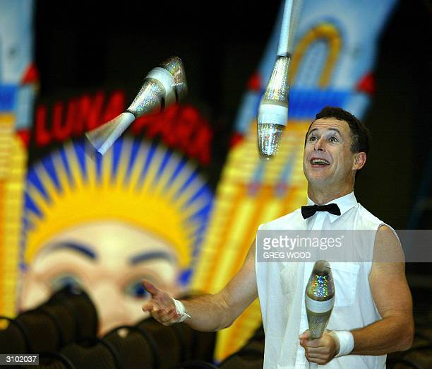 Performer Daniel They juggles in front of a replica of the famous face of Sydney's Luna Park 17 March 2004 during a media tour to show preparations...