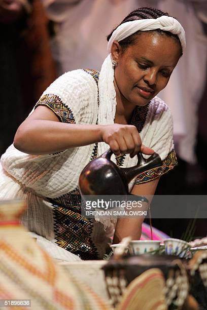 A performer demonstrates the Ethiopian coffee ceremony during a Kwanzaa celebration 26 December 2004 at the Lincoln Theater in Washington Celebrated...