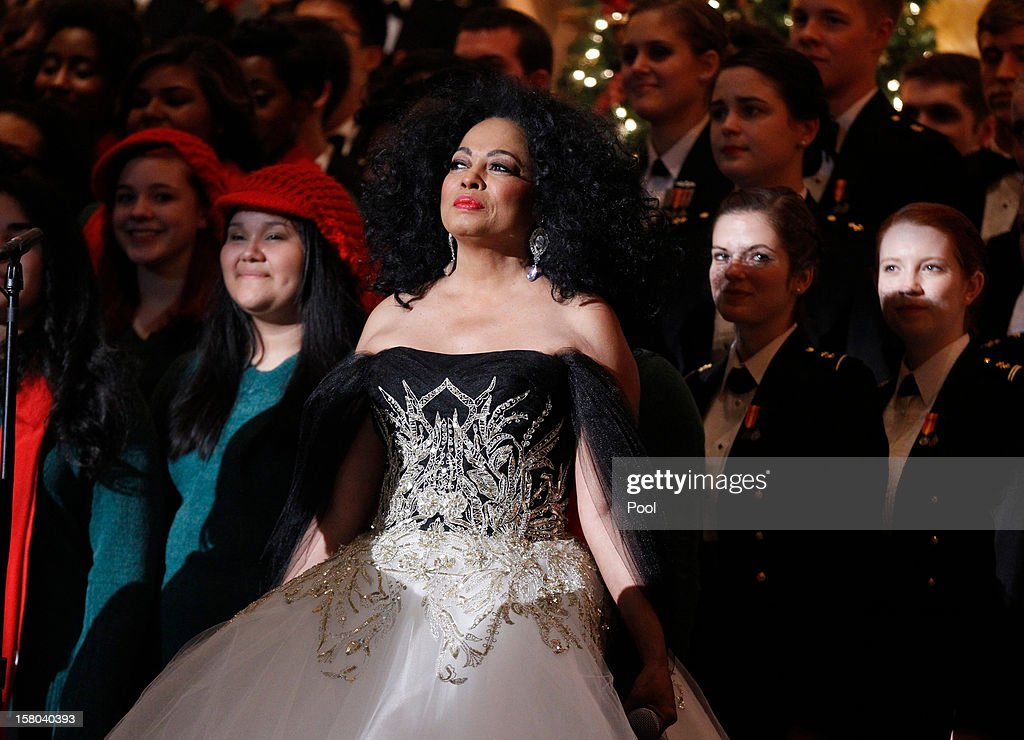 Performer Diana Ross watches as President Barack Obama speaks during the 'Christmas in Washington' concert, attended by President Barack Obama, at the National Building Museum on December 9, 2012 in Washington, D.C. The concert benefits the National Childrens Medical Center and is hosted by comedian Conan O'Brien.