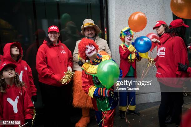 A performer dressed as a clown looks at floats before marching in the Lord Mayor's Show on November 11 2017 in London England The Lord Mayor's Show...