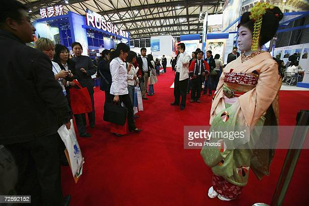 A performer dressed as a geisha promotes Japanese tourism at the 2006 China International Travel Mart on November 17 2006 in Shanghai China The trade...