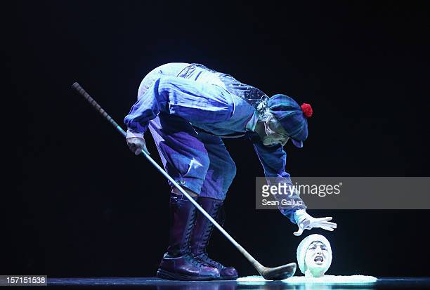 A performer dressed as a golfer gets a surprise from his golf ball during the Corteo production at the Cirque Du Soleil circus dress rehearsal on...