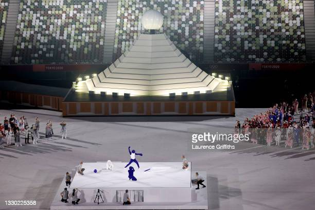Performer dressed as a Pictogram acts out differnet Pictograms during the Opening Ceremony of the Tokyo 2020 Olympic Games at Olympic Stadium on July...