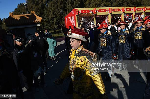 A performer dressed as a Qing Dynasty emperor walks during a recreation of a sacrifice ceremony at Ditan Park or the Altar of the Earth on the eve of...