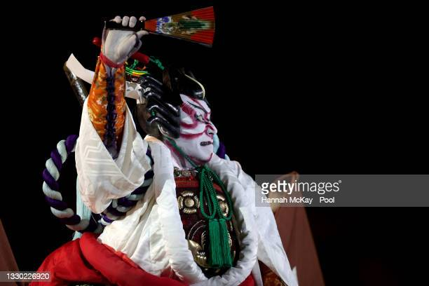 Performer dressed as a Samurai acts out a routine during the Opening Ceremony of the Tokyo 2020 Olympic Games at Olympic Stadium on July 23, 2021 in...