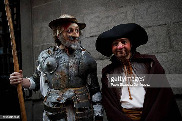 Performer dressed as 'Don Quijote' and 'Sancho Panza' pose for a picture before taking part on the carnival parade on February 14 2015 in Madrid...