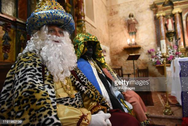 A performer dressed as Gaspar King is seen inside a church during the Cabalgata de Reyes or the Three Kings parade at the Spanish village of Rebollo...
