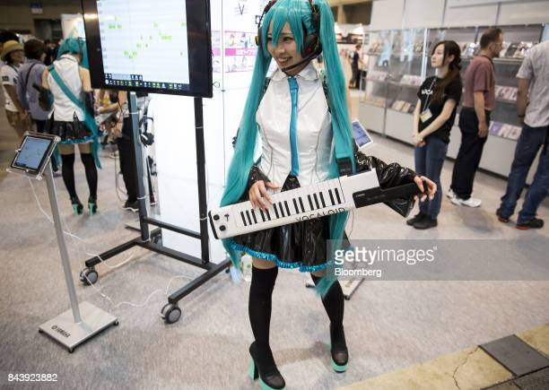 A performer dressed as Hatsune Miku a virtual pop star and the voice behind Crypton Future Media Inc's vocal synthesizer software  performs in the...