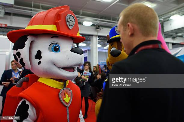 Performer dressed as Marshall from the cartoon PAW Patrol is briefed ahead of the Brand Licensing Europe character parade at Olympia Exhibition...