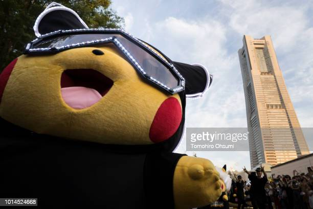 A performer dressed as Pikachu a character from Pokemon series game titles dances during the Pikachu Outbreak event hosted by The Pokemon Co on...