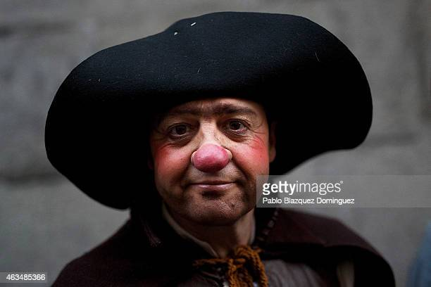 A performer dressed as 'Sancho Panza' poses for a picture before taking part on the carnival parade on February 14 2015 in Madrid Spain The carnival...