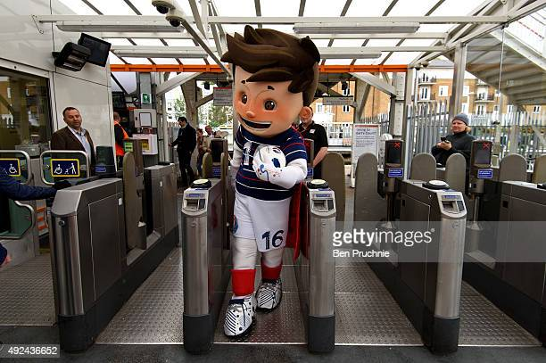 A performer dressed as the Euro 2016 mascot Super Victor departs Olympia Overground Station after the Brand Licensing Europe character parade at...