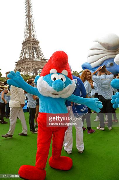 A performer dressed as the Smurf character 'Papa Smurf' takes part to a dance with performers as part of Global Smurfs Day celebrations on June 22...