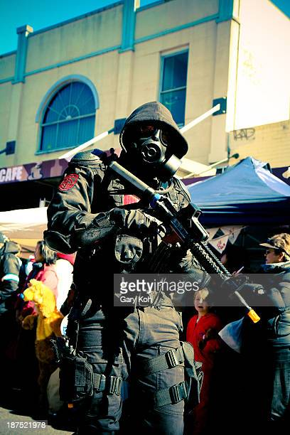 CONTENT] A performer dressed in a militarystyled costume poses for the camera from his position in the parade The Katoomba Winter Magic Festival is...