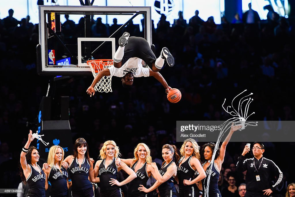 A performer dunks during a game between the Brooklyn Nets and Orlando Magic at the Barclays Center on November 9, 2014 in the Brooklyn borough of New York City.