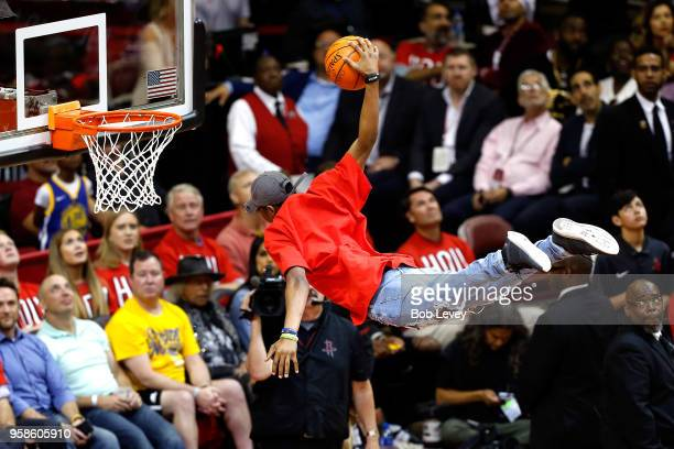 A performer dunks during a stoppage in the first half between the Houston Rockets and the Golden State Warriors in Game One of the Western Conference...