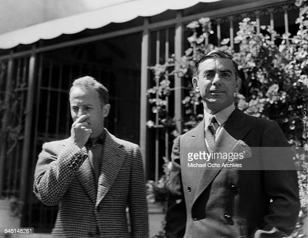 Performer Eddie Cantor and studio head Daryl F Zanuck pose for a photo in Los Angeles California