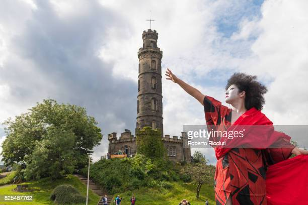 A performer from 'Dr Carnesky's Incredible Bleeding Women' show attends a photocall at Calton Hill during the Edinburgh Festival Fringe on August 2...
