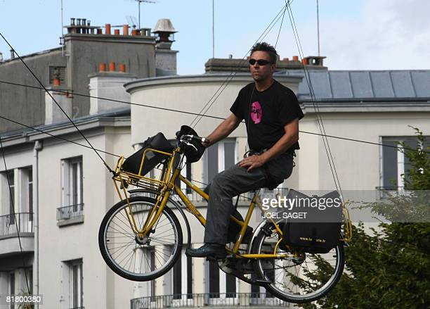 Performer from Generik Vapeur company, riding a cabled hung-up bicycle, attends a rehearsal of the Tour de France launching ceremony, on July 2 2008...