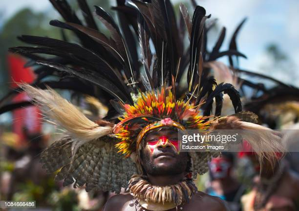 Performer from the Kupop Singsing group from Jiwaka Province performing at Hagen Show at Mt Hagen Papau New Guinea with owl wings in head dress and...