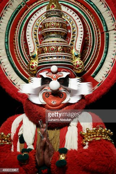 A performer from the Margi Theatre performs a Kathakali on stage during the Kalaa Utsavam Indian Festival of Arts at the Esplanade Outdoor Theatre on...