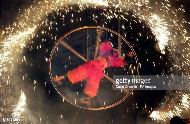 A performer from the Runga Rung group becomes a human catherine wheel while taking part in the Night Afore celebrations in George Street Edinburgh...