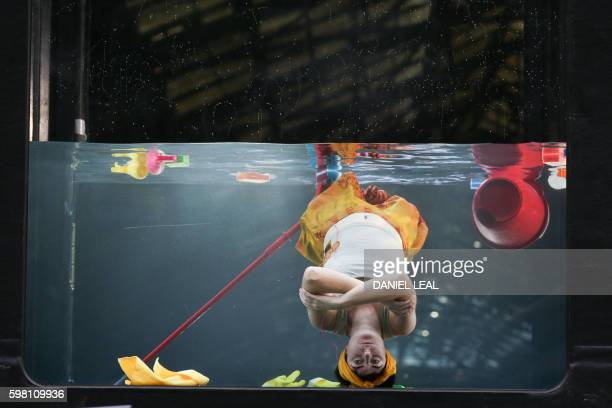 A performer from US based company Early Morning Opera performs daily routines inside a 13foot tank during the rehearsal of 'Holoscenes' as part of...