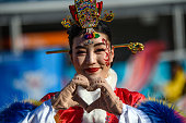 gangneung south korea performer gestures as