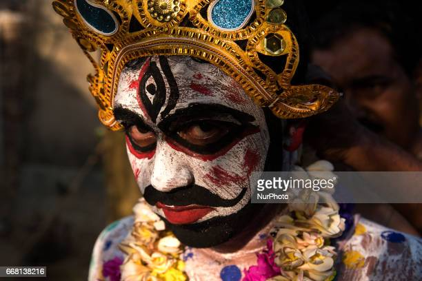 A performer has dressed himself up as a cosmetic deity locally known as quotsoung of gajanquot in Burdwan India on 13 April 2017 quotGajanquot is one...