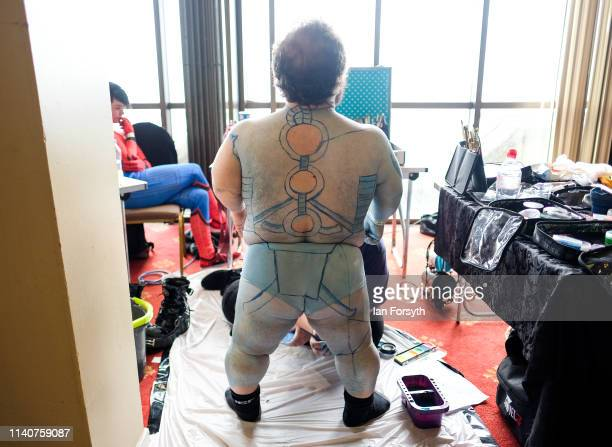Performer has his body painted on the first day of the Scarborough Sci-Fi weekend at the seafront Spa Complex on April 06, 2019 in Scarborough,...