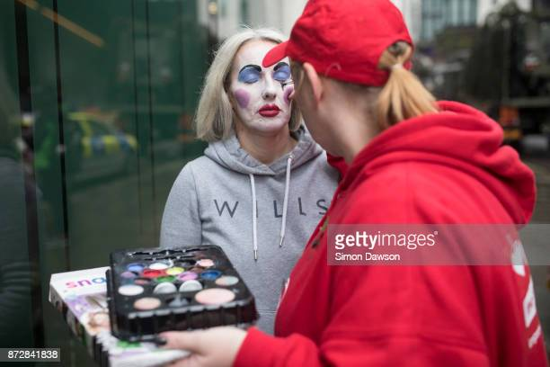 A performer has makeup applied to her face before marching in the Lord Mayor's Show on November 11 2017 in London England The Lord Mayor's Show now...