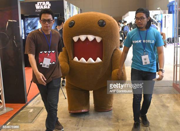 A Performer In Cartoon Character Costume Walks At The Anime Festival Asia Jakarta On