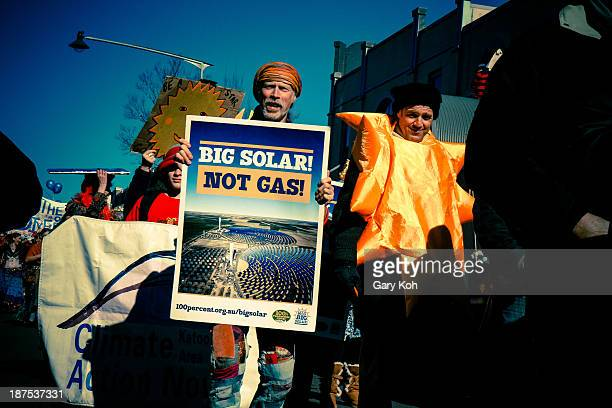 Performer in a street parade uses it as a platform to advocate solar power over traditional gas-based energy sources. The Katoomba Winter Magic...
