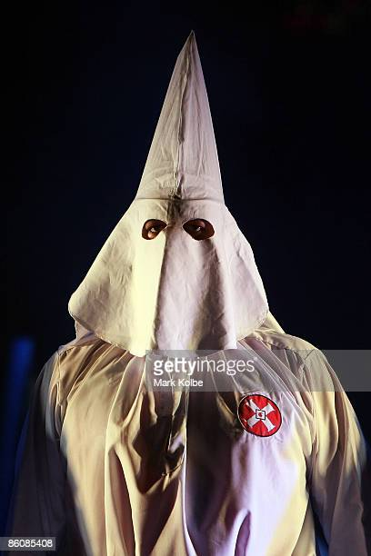 A performer in the Klu Klux Klan dance number stands on stage during the Jerry Springer The Opera photocall at the Sydney Opera House in Sydney...