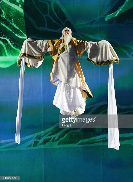 A performer is lowered from the catwalk during the Opening Ceremony of the 14th FINA World Championships at the Oriental Sports Center on July 16...