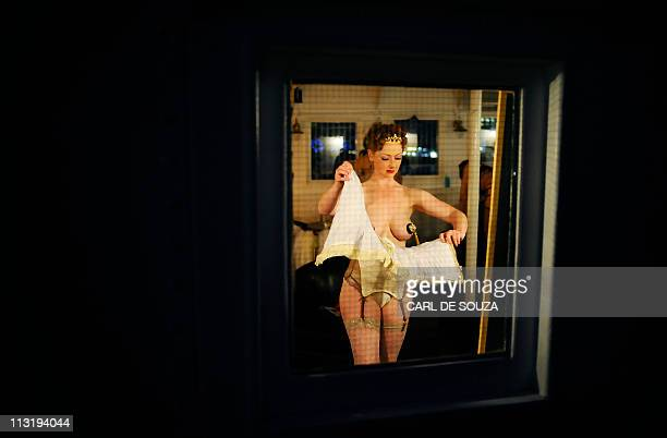 A performer is pictured backstage before the opening show of the 2011 London Burlesque Festival London on April 26 2011 The annual festival features...