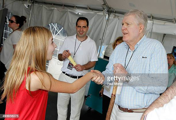 Performer Jackie Evancho shakes hands with Jerry Colbert Executive Producer National Memorial Day Concert backstage at the 25th National Memorial Day...