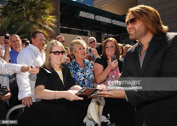 Performer James Otto signs autographs on the red carpet at the 44th annual Academy Of Country Music Awards held at the MGM Grand on April 5 2009 in...