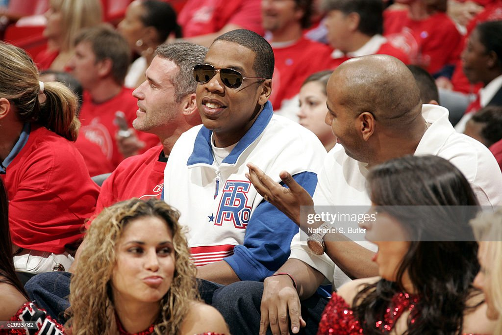 buy online 80f11 69c3f Performer Jay-Z attends a game between the New Jersey Nets ...