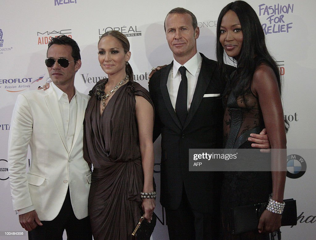 US performer Jennifer Lopez, Marc Anthony, Russian businessman Vladimir Doronin, and British supermodel Naomi Campbell appear during a photocall in Moscow on May 24, 2010 at a gala fashion for charity event.
