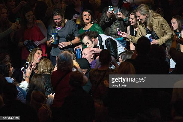 Performer Jimmy Slonina kissing a man's heads during the Pnk The Truth About Love' tour at Bankers Life Fieldhouse on November 21 2013 in...