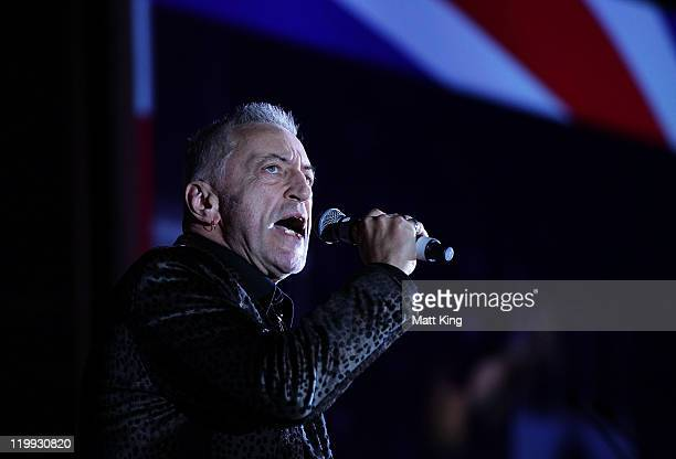 Performer Jon Waters sings on stage during the Australian Olympic Committee Black Tie Dinner at the Sydney Convention Exhibition Centre on July 27...