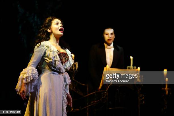 Performer Jonathan Roxmouth plays 'The Phantom' and Meghan Picerno plays 'Christine Daae' in the musical The Phantom Of The Opera during a media...