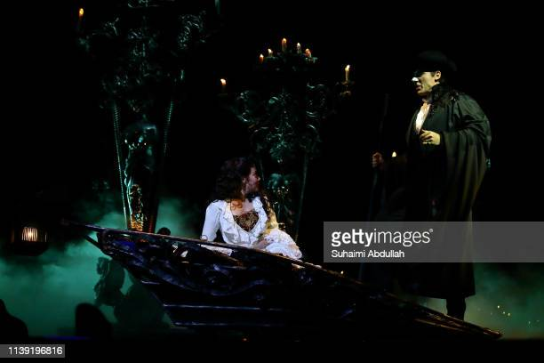 Performer Jonathan Roxmouth plays 'The Phantom' and Meghan Picerno plays 'Christine Daae' in the musical, The Phantom Of The Opera during a media...