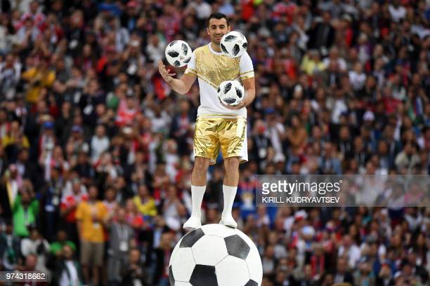 TOPSHOT A performer juggles with 3 footballs during the Opening Ceremony before the Russia 2018 World Cup Group A football match between Russia and...